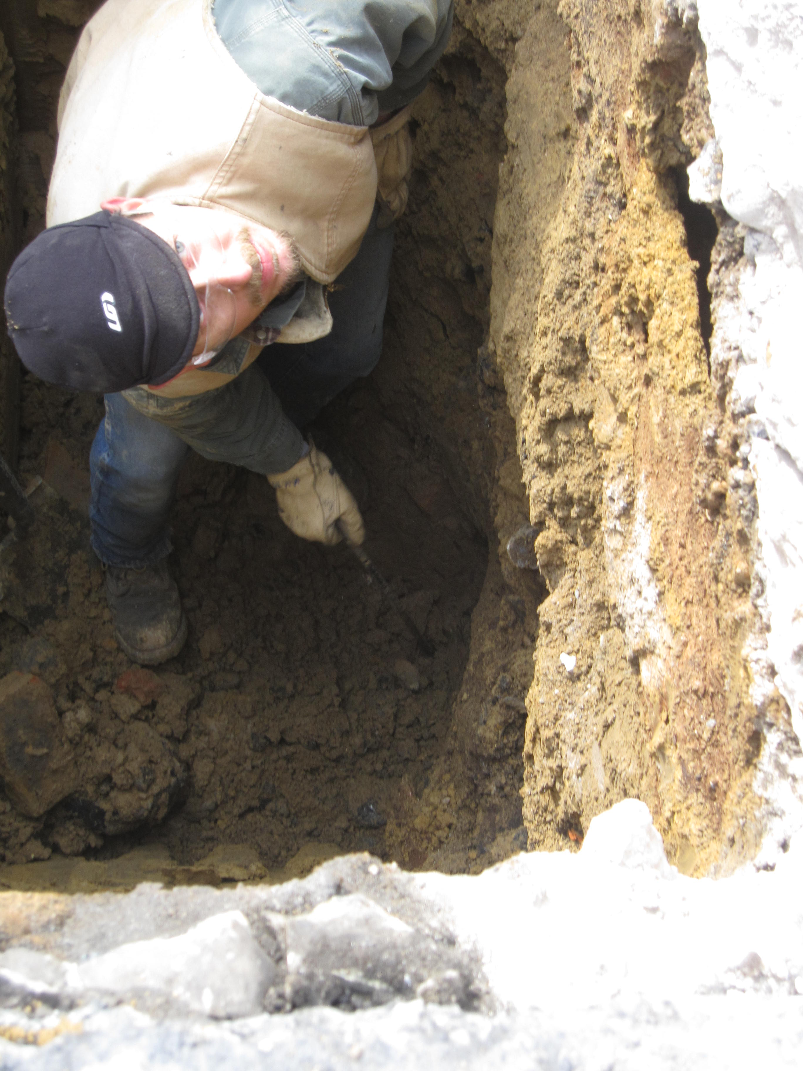 Curb trap main drain sewer lateral and water service