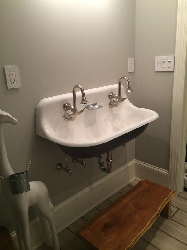 Double faucet bathroom sink